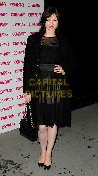 SOPHIE ELLIS BEXTOR .Company magazine's 30th Birthday Party at Proud Galleries, Camden, London, England, UK, .October 1st 2008 .full length black sheer dress see through layered coat hand on hip bag shoes Chanel Ellis-Bextor .CAP/CAN.©Can Nguyen/Capital Pictures.