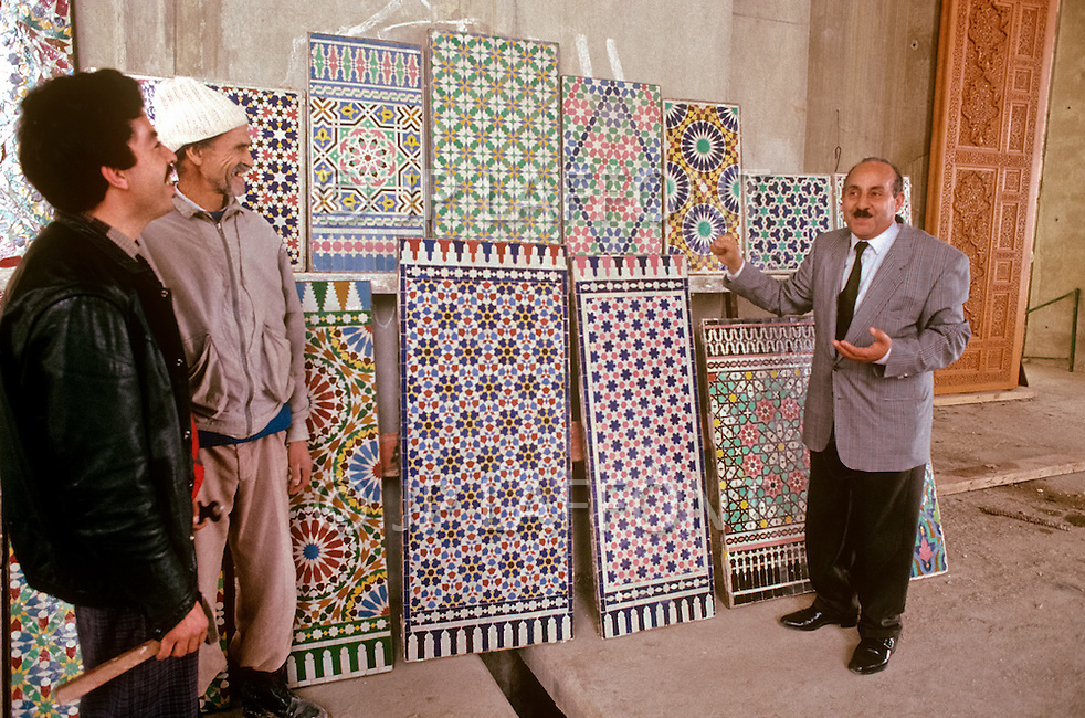 March 9, 1989, Casablanca, Morocco. Zelige making is a traditional Moroccan art craft. Small pieces of ceramic tiles are cut,  and put together in a vast variety of geometrical patterns to form the final piece as it is here shown by a craft master. It was widely used for the decoration of the Hassan II Mosque. The mosque was completed in 1993.