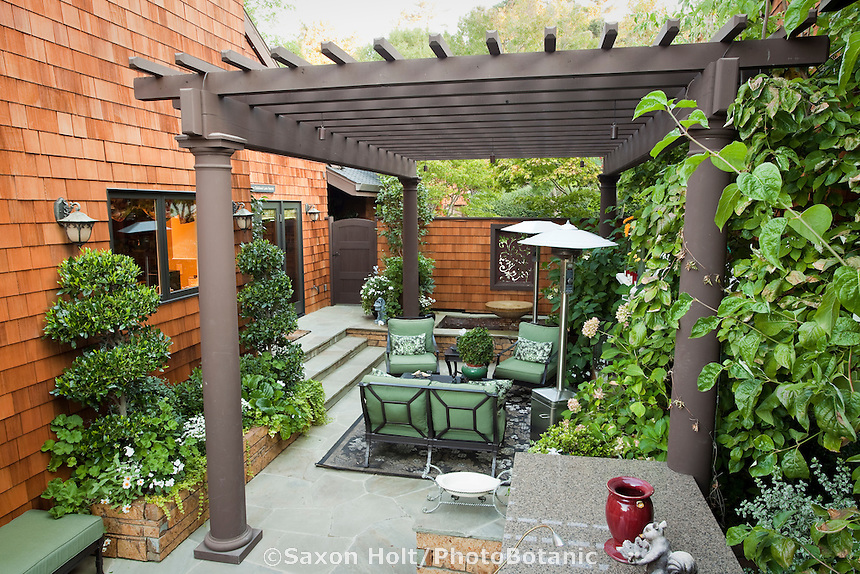 Shade structure sheltering small space urban townhome patio garden
