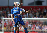 Wimbledon's Mitch Pinnock battles with Fleetwood Town's Tommy Spurr<br /> <br /> Photographer Stephen White/CameraSport<br /> <br /> The EFL Sky Bet League One - Fleetwood Town v AFC Wimbledon - Saturday 4th August 2018 - Highbury Stadium - Fleetwood<br /> <br /> World Copyright &copy; 2018 CameraSport. All rights reserved. 43 Linden Ave. Countesthorpe. Leicester. England. LE8 5PG - Tel: +44 (0) 116 277 4147 - admin@camerasport.com - www.camerasport.com