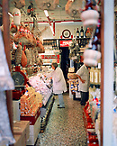 ITALY, Verona, senior woman shopping in butcher's shop