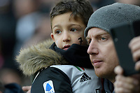 6th January 2020; Allianz Stadium, Turin, Italy; Serie A Football, Juventus versus Cagliari; A father and son wait for the game to start - Editorial Use