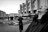 "Norilsk, Russia  .May-June 1997.Young kids hang out in the center of the nickel mining town of Norilsk at 1 AM as there is 24 hrs of sun in May. Their favorite music, ""Industrial Music"" favorite group, ""Ministry"",  favorite song, ""Thank Your for My Mutation"".."