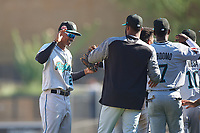 Salt River Rafters second baseman Jose Devers (2), of the Miami Marlins organization, celebrates with teammates after winning the Arizona Fall League Championship Game against the Surprise Saguaros on October 26, 2019 at Salt River Fields at Talking Stick in Scottsdale, Arizona. The Rafters defeated the Saguaros 5-1. (Zachary Lucy/Four Seam Images)