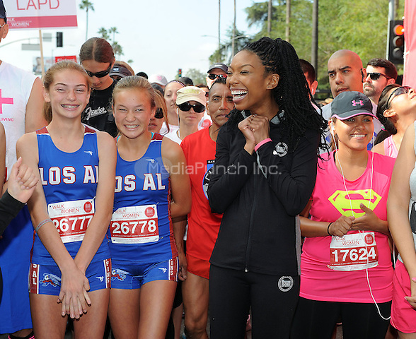 LOS ANGELES - MAY 10:  Brandy poses with runners at the 21st Annual EIF Revlon Run/Walk For Women at Los Angeles Memorial Coliseum at Exposition Park on May 10, 2014 in Los Angeles, California.  PGMicelotta/MediaPunch