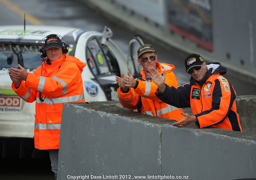 Official congratulate the drivers after race three during Round Three of the V8 Supertourers Sprint Races at Manfeild Autocourse, Feilding, New Zealand on Sunday, 29 April 2012. Photo: Dave Lintott / lintottphoto.co.nz