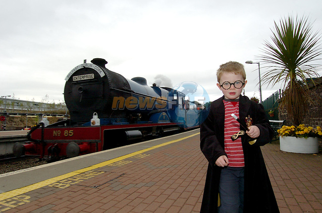 Fionn Sweeney-Logue in his Harry Potter outfit watching the Enterprise steam Train arrive at Drogheda McBride Station..Photo NEWSFILE/FRAN CAFFREY..(Photo credit should read FRAN CAFFREY/NEWSFILE)...This Picture has been sent you under the condtions enclosed by:.Newsfile Ltd..the Studio,.Millmount Abbey,.Drogheda,.Co Meath..Ireland..Tel: +353(0)41-9871240.Fax: +353(0)41-9871260.GSM: +353(0)86-2500958.email: pictures@newsfile.ie.www.newsfile.ie.FTP: 193.120.102.198..This picture is from Fran Caffrey@newsfile.ie