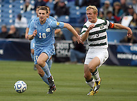 North Carolina;s Billy Schuler (10) battles with Charlotte's Isaac Cowles (3) during the NCAA 2011 Men's College Cup in Hoover, AL on Sunday, December 11, 2011.