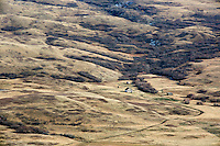 An old homestead can be seen among the hills on a ranch south of Ulm, Montana, USA.