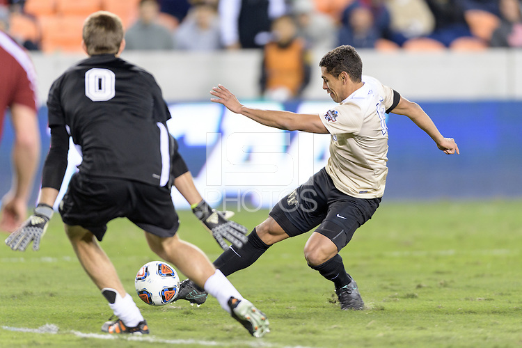 Houston, TX - Friday December 9, 2016: Steven Echevarria (15) of the Wake Forest Demon Deacons attempts a shot at the Denver Pioneers goal in the second half of the NCAA Men's Soccer Semifinals at BBVA Compass Stadium.