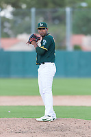 Oakland Athletics relief pitcher Leudeny Pineda (59) gets ready to deliver a pitch during an exhibition game against Team Italy at Lew Wolff Training Complex on October 3, 2018 in Mesa, Arizona. (Zachary Lucy/Four Seam Images)