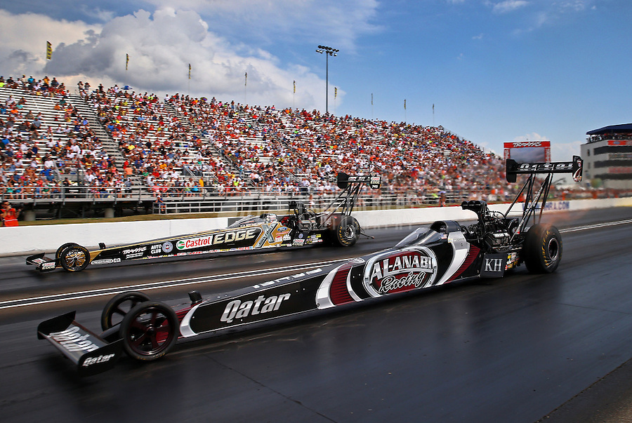 Aug. 31, 2013; Clermont, IN, USA: NHRA top fuel dragster driver Shawn Langdon (near) races alongside Brittany Force during the Traxxas Shootout at the US Nationals at Lucas Oil Raceway. Mandatory Credit: Mark J. Rebilas-