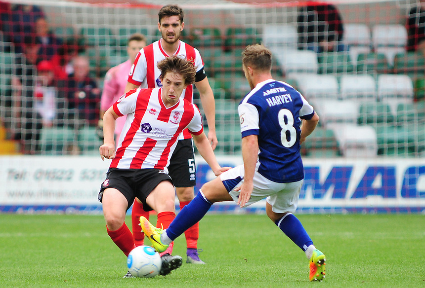 Lincoln City's Alex Woodyard vies for possession with Barrow's Alex-Ray Harvey<br /> <br /> Photographer Andrew Vaughan/CameraSport<br /> <br /> Vanarama National League - Lincoln City v Barrow - Saturday 17 September 2016 - Sincil Bank - Lincoln<br /> <br /> World Copyright &copy; 2016 CameraSport. All rights reserved. 43 Linden Ave. Countesthorpe. Leicester. England. LE8 5PG - Tel: +44 (0) 116 277 4147 - admin@camerasport.com - www.camerasport.com