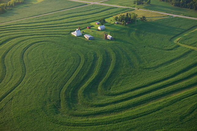 Contour fields accented by farm buildings