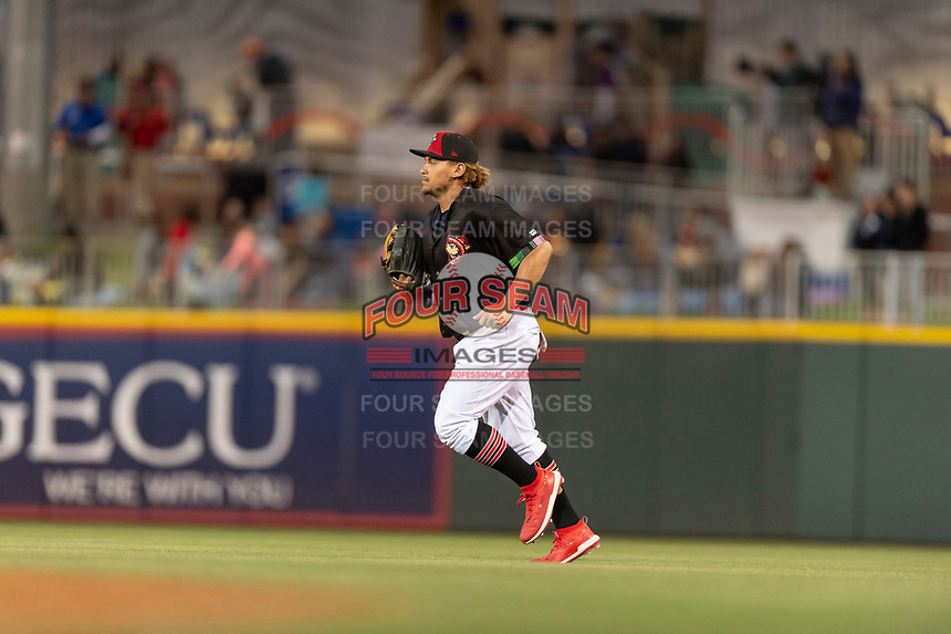 El Paso Chihuahuas right fielder Josh Naylor (27) jogs off the field between innings of a Pacific Coast League game against the Albuquerque Isotopes at Southwest University Park on May 10, 2019 in El Paso, Texas. Albuquerque defeated El Paso 2-1. (Zachary Lucy/Four Seam Images)