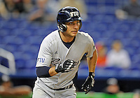 Florida International University infielder/outfielder Tyler James Shantz (5) plays against the Miami Marlins, which won the game 5-1 on March 7, 2012 at Miami, Florida. .