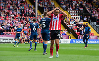 Lincoln City's Tyler Walker reacts after failing to convert a first half chance<br /> <br /> Photographer Chris Vaughan/CameraSport<br /> <br /> The EFL Sky Bet League One - Lincoln City v Bristol Rovers - Saturday 14th September 2019 - Sincil Bank - Lincoln<br /> <br /> World Copyright © 2019 CameraSport. All rights reserved. 43 Linden Ave. Countesthorpe. Leicester. England. LE8 5PG - Tel: +44 (0) 116 277 4147 - admin@camerasport.com - www.camerasport.com