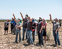Spectators track a rocket at the Spaceport America Cup near the town of Truth or Consequences, New Mexico, Thursday, June 22, 2017. The International Intercollegiate Rocket Engineering Competition hosted over 110 teams from colleges and universities in eleven countries. Students launched solid, liquid, and hybrid rockets to target altitudes of 10,000 and 30,000 feet. The 2017 Spaceport America Cup winner was the University of Michigan, Ann Arbor, Team 79.<br /> <br /> Photo by Matt Nager