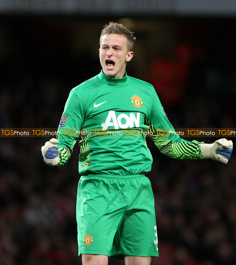 Anders Lindegaard celebrates after Antonio Valencia scored the 1st goal for Manchester United - Arsenal vs Manchester United, Barclays Premier League at The Emirates, Arsenal - 22/01/12- MANDATORY CREDIT: Rob Newell/TGSPHOTO - Self billing applies where appropriate - 0845 094 6026 - contact@tgsphoto.co.uk - NO UNPAID USE.