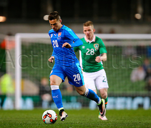 29.03.2016. Aviva Stadium, Dublin, Ireland. International Football Friendly Rep. of Ireland versus Slovakia. Robert Mak (Slovakia) gets away from Jonathan Hayes (Rep. of Ireland).