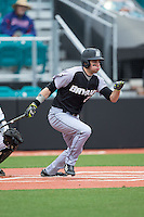 Robby Rinn (25) of the Bryant Bulldogs follows through on his swing against the Coastal Carolina Chanticleers at Springs Brooks Stadium on March 13, 2015 in Charlotte, North Carolina.  The Chanticleers defeated the Bulldogs 7-2.  (Brian Westerholt/Four Seam Images)