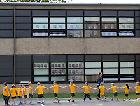 A group of students walk single file while they await the drone at Nativity of Our Lord school Monday September 21, 2015 in Warminster, Pennsylvania.   (Photo By William Thomas Cain)