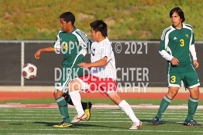 Redondo Beach, CA 02/01/10 - Indheca Wycoff (Mira Costa #14), Augie Diaz (Mira Costa #13) and Masaya Kawauchi (Redondo Union #10) in action during the Bay League Boys Varsity Soccer game between Mira Costa and Redondo Union.
