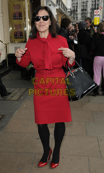ARLENE PHILLIPS.Attending the 'Sweet Charity' Press Night at the Theatre Royal, Haymarket, London, England UK, May 4th 2010. .full length black sunglasses red Ray Bans wayfarers dress tights bag purse shoes philips hands funny.CAP/CAN.©Can Nguyen/Capital Pictures.