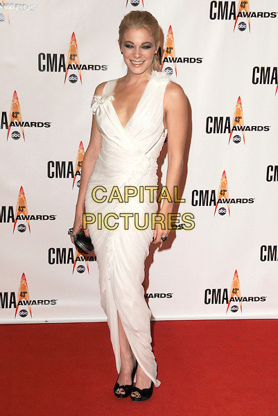 LeANN RIMES .Attending the 43rd Annual CMA Awards held at the Sommet Center, Nashville, Tennessee, USA, 11th November 2008..arrivals country music full length long maxi dress white  rosette on shoulder zip sleeveless black shoes peep toe clutch bag ruched clutch bag ring low cut .CAP/ADM/GS.©George Shepherd/AdMedia/Capital Pictures.