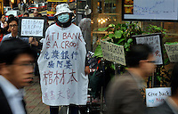 "Hong Kong investors demosntrate outside Citibank in Central District, Hong Kong. The demonstrators who lost much of their savings after Citi sold them financial products backed by Lehman denouncing Citi as a ""devil bank"" that ""swindled us out of our life savings.""."