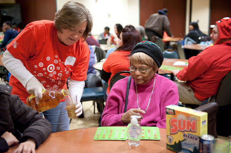 Chicago Public School student volunteering at LaSalle Senior Center in Chicago during Chicago Cares Celebration of Service Martin Luther King day.
