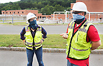 WATERBURY CT. - 31 July 2020-073120SV02-From left, Project managers, Paola Molloy and Chris Smith talk outside the sewage treatment plant in Waterbury Friday. Last year saw a flood of complaints about sewage stink from the Waterbury sewage treatment plant, this year has seen hardly any. They have made improvement to the facility.<br /> Steven Valenti Republican-American