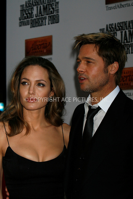 WWW.ACEPIXS.COM . . . . . ....September 18 2007, New York City....Actors Angelina Jolie and Brad Pitt arriving at the New York Premiere of 'The Assassination Of Jesse James By The Coward Robert Ford' at the Ziegfeld Theatre in midtown Manhattan.....Please byline: NANCY RIVERA - ACEPIXS.COM.. . . . . . ..Ace Pictures, Inc:  ..tel: (646) 679 0430..e-mail: picturedesk@acepixs.com..web: http://www.acepixs.com
