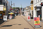 Almost deserted main shopping street at noon on very hot summer day,  Sliedrecht, Netherlands