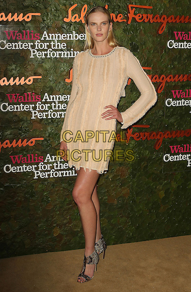 Anne V<br /> Wallis Annenberg Center For The Performing Arts Inaugural Gala held at Wallis Annenberg Center For The Performing Arts,  Beverly Hills, California, USA, 17th October 2013.<br /> full length beige nude long sleeve dress hand on hip <br /> CAP/ADM/KB<br /> &copy;Kevan Brooks/AdMedia/Capital Pictures