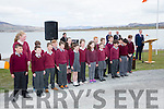 Children from Scoil Dar Earca perform 'Amhrán na bhFiann' accompanied by Gavan Ring.
