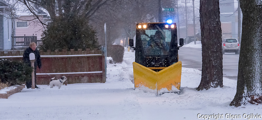 City of Sarnia worker Tom Gibson drives a trackless sidewalk snowplow along Campbell Street clearing the way for safe passage.