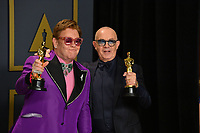 LOS ANGELES, USA. February 09, 2020: Elton John & Bernie Taupin at the 92nd Academy Awards at the Dolby Theatre.<br /> Picture: Paul Smith/Featureflash