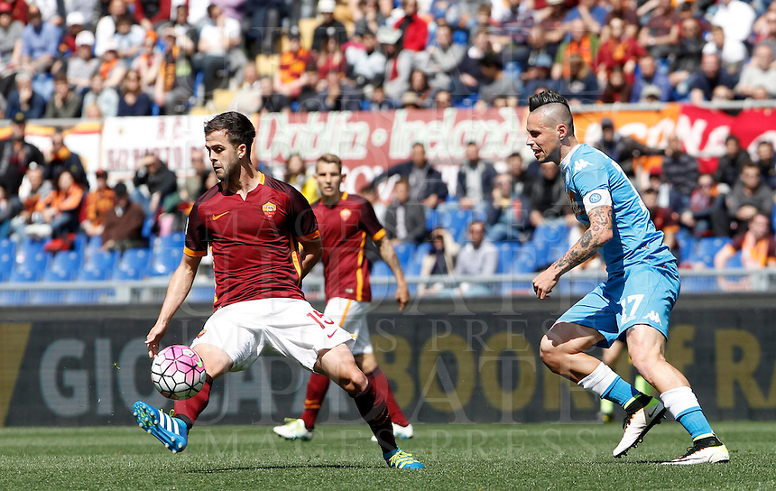 Calcio, Serie A: Roma vs Napoli. Roma, stadio Olimpico, 25 aprile 2016.<br /> Napoli's Marek Hamsik, right, kicks the ball past Roma's Miralem Pjanic during the Italian Serie A football match between Roma and Napoli at Rome's Olympic stadium, 25 April 2016. <br /> UPDATE IMAGES PRESS/Isabella Bonotto