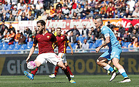 Calcio, Serie A: Roma vs Napoli. Roma, stadio Olimpico, 25 aprile 2016.<br /> Napoli&rsquo;s Marek Hamsik, right, kicks the ball past Roma&rsquo;s Miralem Pjanic during the Italian Serie A football match between Roma and Napoli at Rome's Olympic stadium, 25 April 2016. <br /> UPDATE IMAGES PRESS/Isabella Bonotto