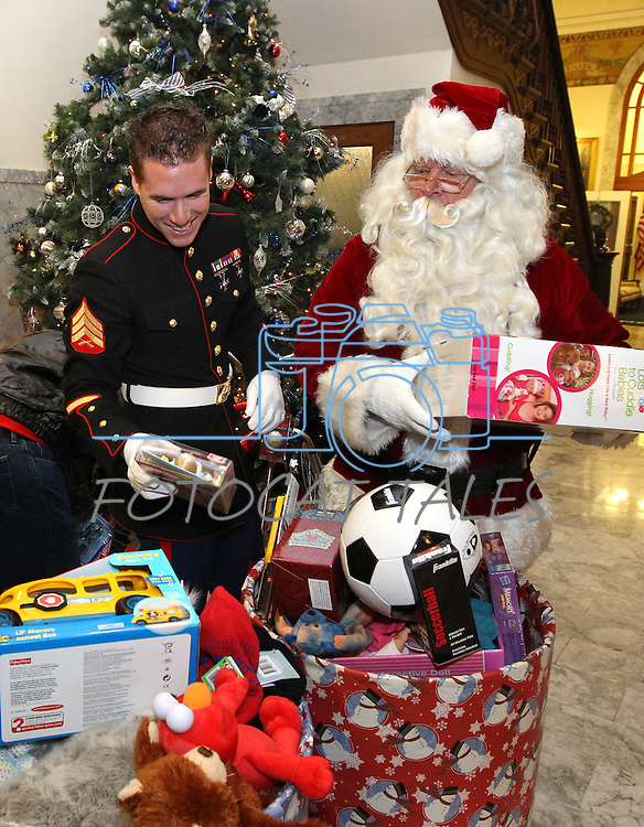 Marine Sgt. Justin Block and Santa load toy barrels Friday morning, Dec. 17, 2010, as part of the Toys for Tots toy drive at the Capitol in Carson City, Nev. .Photo by Cathleen Allison
