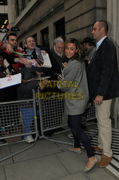 Jessica Ennis .At BBC Radio 2, London, England..9th November 2012.full length grey gray jacket coat jeans denim side fans crowd signing autographs looking over shoulder .CAP/IA.©Ian Allis/Capital Pictures.