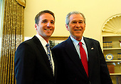 United States President George W. Bush participates in a Photo Opportunity with the 2008 National Teacher of the Year, Mike Geisen, in the Oval Office of the White House, Washington, April 30 2008. Mike Geisen, is a teacher at Crook County Middle School in Prineville, Oregon.<br /> Credit: Aude Guerrucci / Pool via CNP