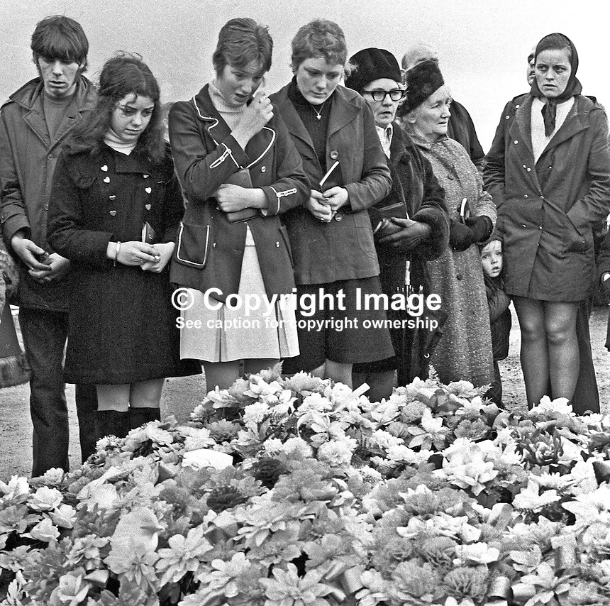 The first anniversary of Bloody Sunday is marked by family and friends of the deceased placing flowers on their graves in the City Cemetry, Londonderry, N Ireland, UK. Bloody Sunday was the name given to the controversial shooting dead of 13 people by the British Army's Parachute Regiment during a Civil Rights March on 30 January 1972. A fourteenth died several months later. 197301280039g<br /> <br /> Copyright Image from Victor Patterson, 54 Dorchester Park, Belfast, UK, BT9 6RJ<br /> <br /> t: +44 28 90661296<br /> m: +44 7802 353836<br /> vm: +44 20 88167153<br /> e1: victorpatterson@me.com<br /> e2: victorpatterson@gmail.com<br /> <br /> For my Terms and Conditions of Use go to www.victorpatterson.com