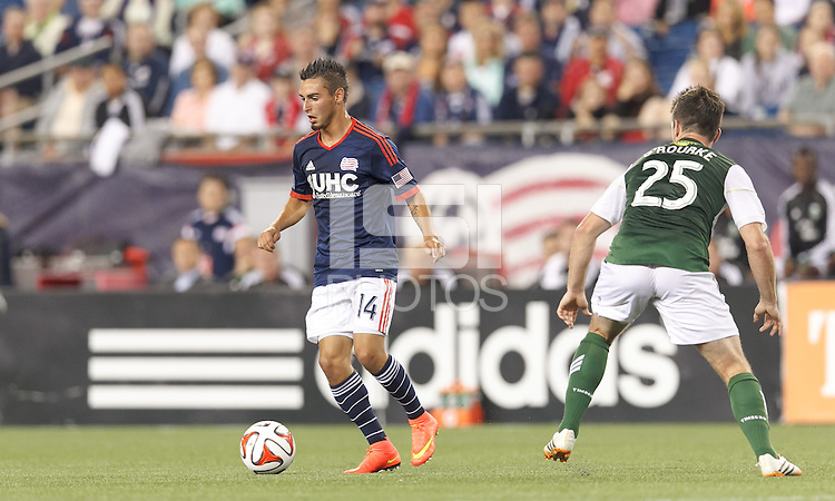 Foxborough, Massachusetts - August 16, 2014: First half action. In a Major League Soccer (MLS) match, the New England Revolution (blue/white) vs Portland Timbers (green/white), 1-0 (halftime), at Gillette Stadium.