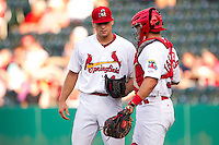 Trevor Rosenthal (44) of the Springfield Cardinals talks with Travis Tartamella (36) during a game against the Arkansas Travelers at Hammons Field on June 13, 2012 in Springfield, Missouri. (David Welker/Four Seam Images)