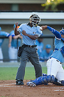 Home plate umpire Darrell Roberts makes a strike call during the Appalachian League game between the Danville Braves and the Burlington Royals at Burlington Athletic Park on August 13, 2015 in Burlington, North Carolina.  The Braves defeated the Royals 6-3. (Brian Westerholt/Four Seam Images)