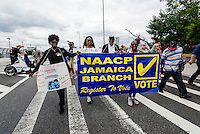 Staten Island, NY - 23 Aug 2014 - Members of the Jamaica NAACP depart the St George ferry terminal to join the march calling for Justice for Eric Garner, an African American man who died in NYPD custody as a result of an illegal choke hold