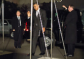 United States President Barack Obama waves as he returns to the White House in Washington, D.C. after winning reelection on Wednesday, November 7, 2012.  He his followed by First Lady Michelle Obama and his daughters Melia and Sasha..Credit: Joshua Roberts / Pool via CNP