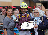 September 3, 2012. Easter Gift, ridden by Kendrick Carmouche and trained by Nick Zito, wins the grade III Smarty Jones Stakes at Parx Racing. Pat Chapman, owner of Smarty Jones, joins Carmouche in the winner's circle. (Joan Fairman Kanes/Eclipse Sportswire)